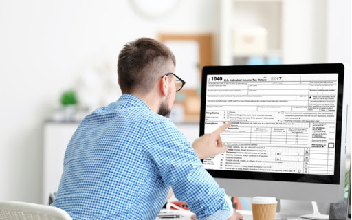 Image showing a man looking at a form on a computer. Use our eSign app to eSign documents easily, securely, and in almost any industry! Read more to find out how professionals use eSign Genie!