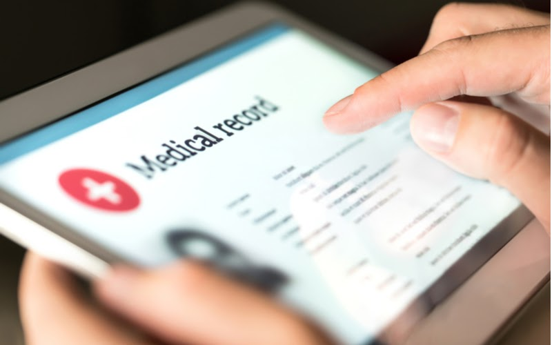 Image showing a medical record being viewed on a tablet. Use our eSign app to eSign documents easily, securely, and in almost any industry! Read more to find out how professionals use eSign Genie!