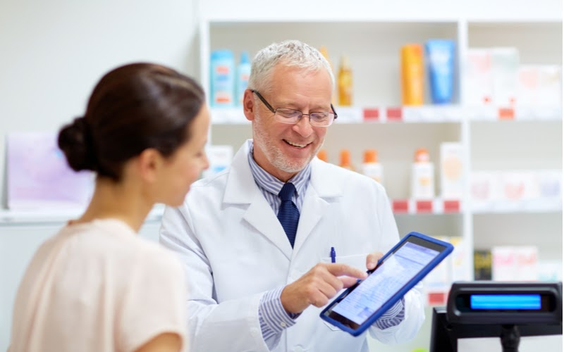 Image representing a healthcare worker viewing a doctor signature electronically with a physician.