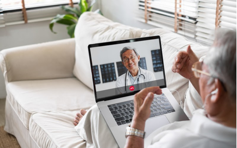 A patient attending a telehealth appointment with their doctor