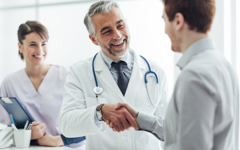 Physician shaking hands with a patient