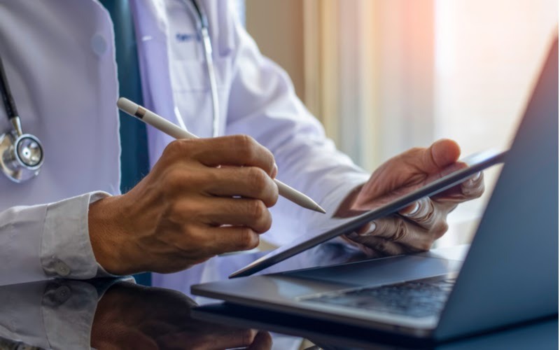 Doctor using tablet for electronic signatures during telehealth session