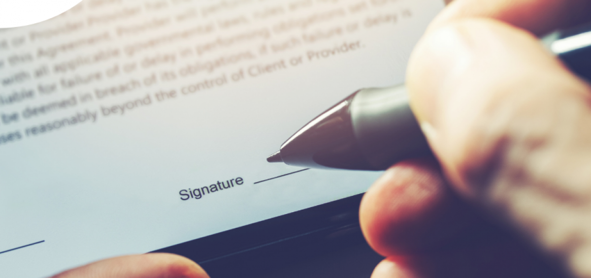 Image of someone signing using a signature maker