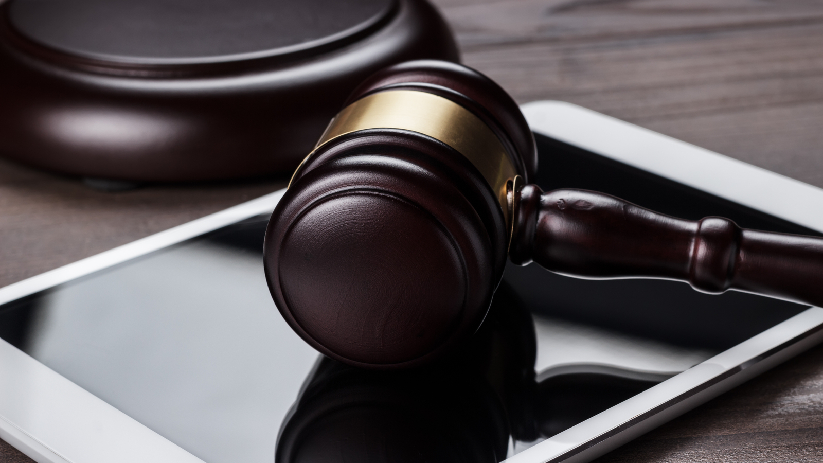 Image showing a tablet and gavel. Learn how electronic signatures are court admissible with audit trails.