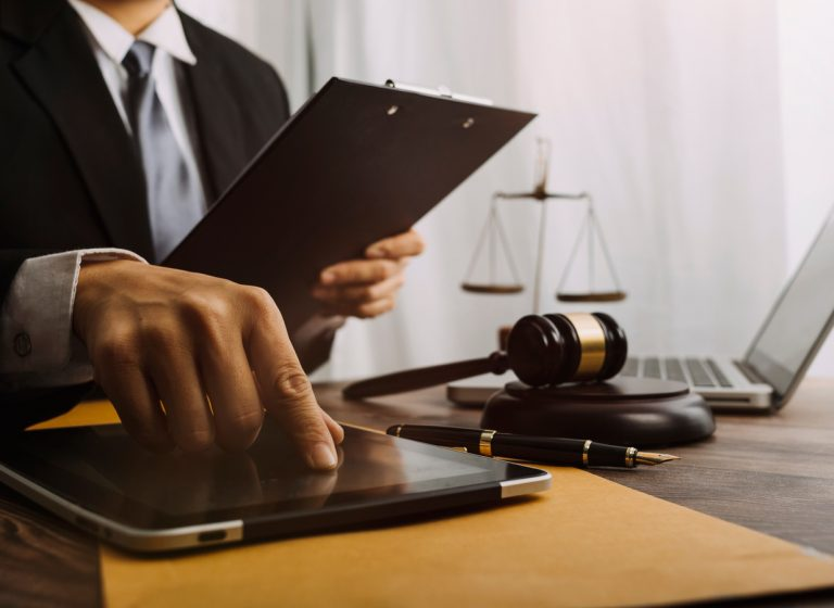Image showing judge using a tablet, gavel. Learn how electronic signatures are court admissible with audit trails.
