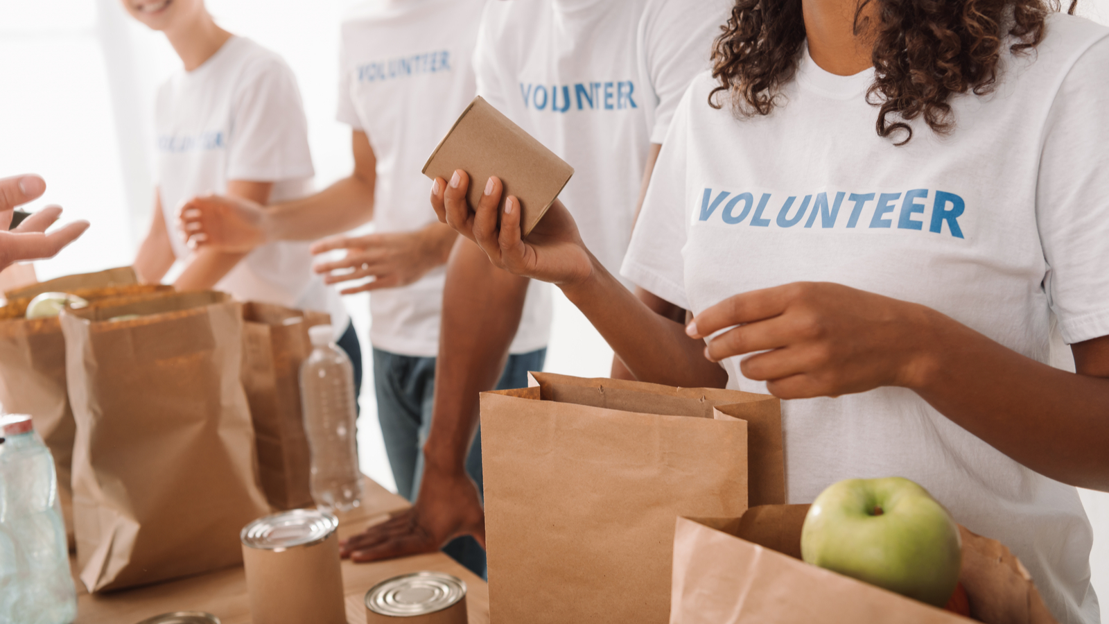Image shows charity organization volunteers. The right tools for nonprofits are essential for these heroes of the charitable industry.